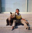 Turkey, Istanbul, gypsy boy with his dancing bear