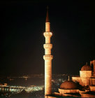 Turkey Istanbul illuminated minaret of the Suleymaniye Mosque and beyond the Golden Horn and the Bosphorus