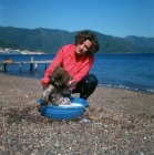 Turkey, Marmaris, bear cub being bathed to remove salt after swimming in the sea