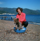Turkey, Marmaris, bathing a young bear to remove the salt after going in the sea