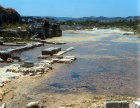 Part of agora partially submerged in weed covered water, Miletus, Turkey