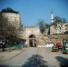 Silivri Kapise, one of eleven gates in the city walls, with minaret of Kadim Ibrahim Pasa Mosque, Istanbul, Turkey