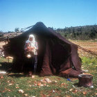 Yuruk nomad woman spinning outside her tent in the Taurus mountains north of Tarsus, Cilicia, Turkey