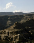 Yemen, rock palace in Wadi Dahr and mountains