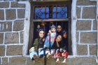 Children in window, Jibla, Yemen