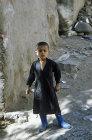 Boy in blue wellies, Jibla, Yemen