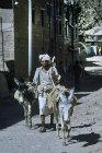Man and donkeys, Jibla, Yemen