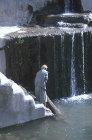 Man beside pool, Hadda, near Sana