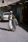Boy leading blind man, Sana
