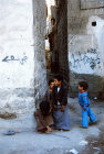 Little boys playing in street, Sana