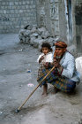 Man and child in street, Sana