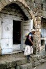 Man outside his shop, Manakha, Yemen